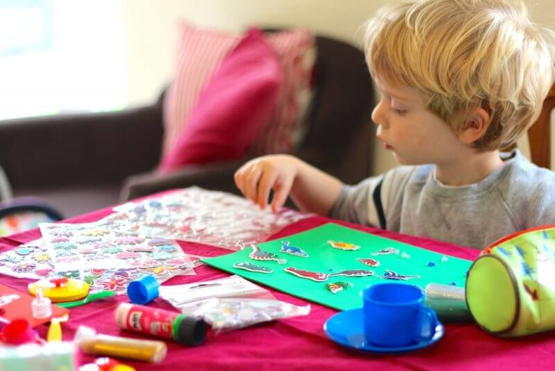 A child making crafts - making toys for children with ASD