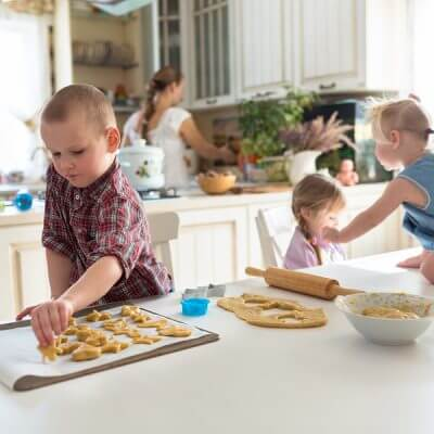 children with her mother preparing cookies independent children large family. casual lifestyle photo series in real life interior learning Nurturing independence with autism