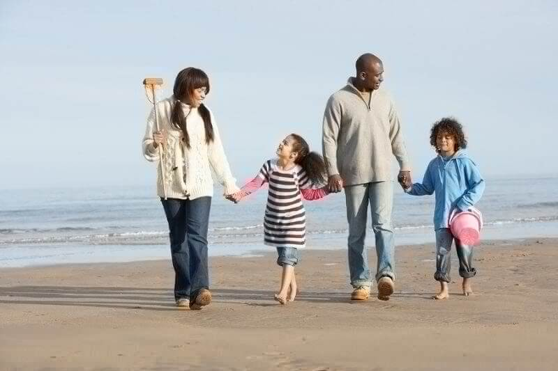 Black family on a beach...summer vacation with kids with ASD