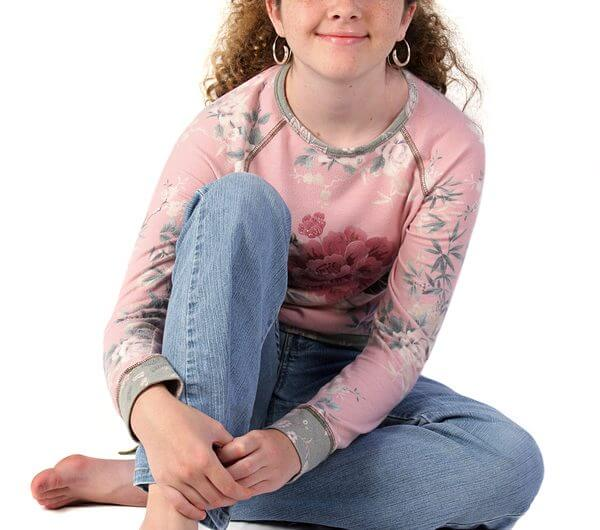 A full view of a casual, stylishly dressed teenaged girl. Teaching menstruation to girls with autism