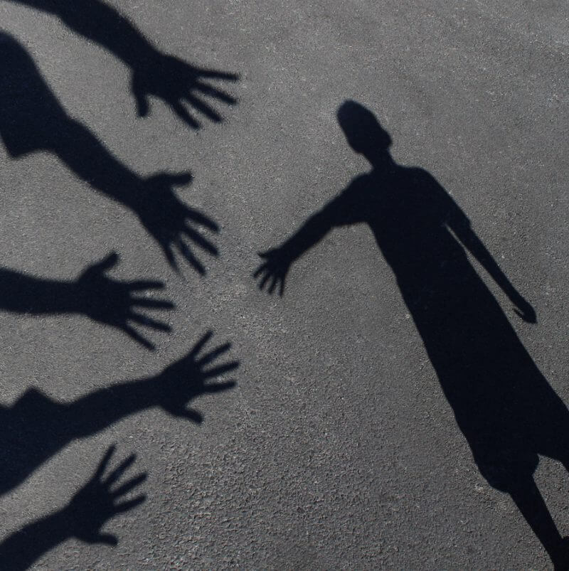 Therapy. A shadow of a child reaching for other hands to help