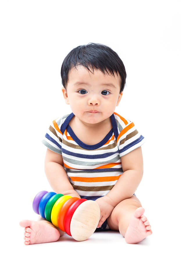 Cute aisan baby. Not smiling. Signs that your infant could have autism