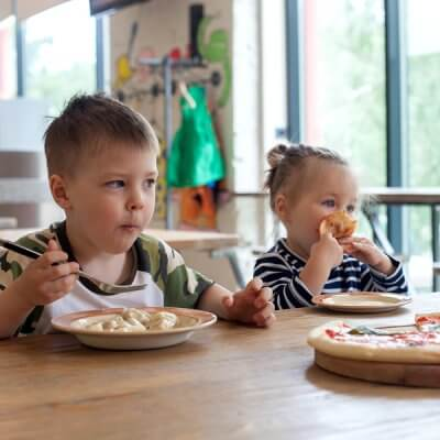 Two kids eating pizza...how to make gluten free dairy free choices for kids with autism
