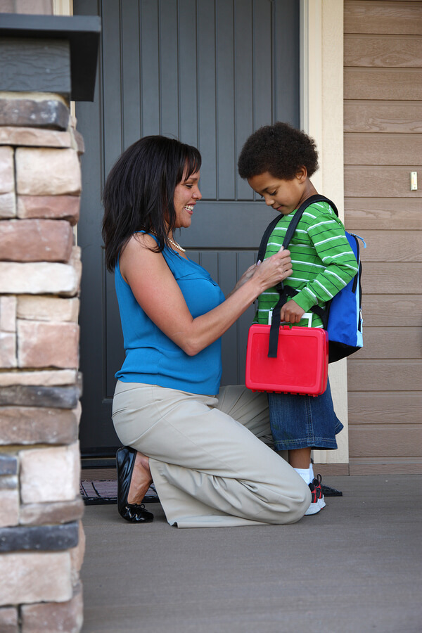 Mother gets child with autism ready for first day of school