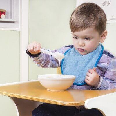 Toddler looking at his food with no appetite