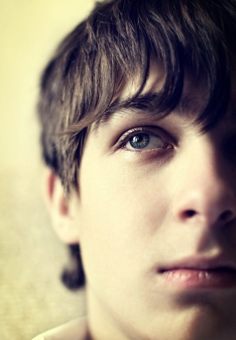 Toned Photo of Sad Teenager with anxiety Face closeup with Focus on an Eye