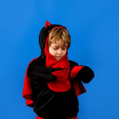 Tips for Parents of Children with Autism during Halloween: a small boy in a dragon costume