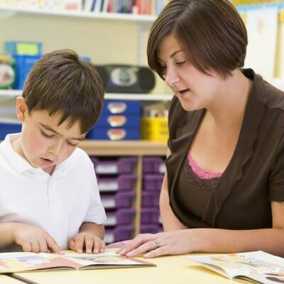 Child learning to read and literacy skills with ASD