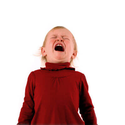 A toddler girl clearly upset and unhappy with a temper tantrum and autism