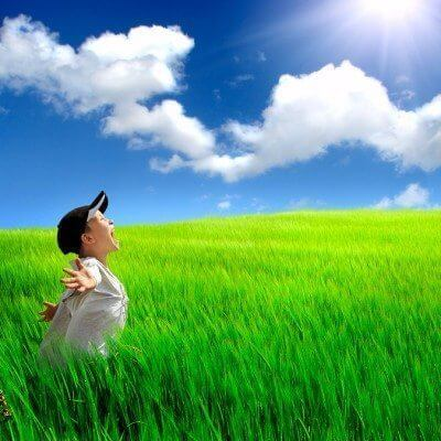 The happy child with autism on a summer field: changing to triad of impairment to something positive