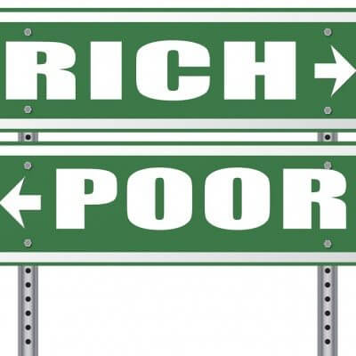 rich or poor take financial risk live in wealth good or bad luck and change fortune wealthy or poverty road sign arrow