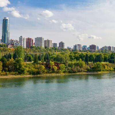 Wide angle photograpgh of Edmonton, Alberta showing the city buildings along the river