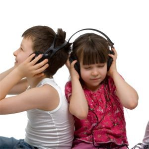Yung children listening to music with large headphones