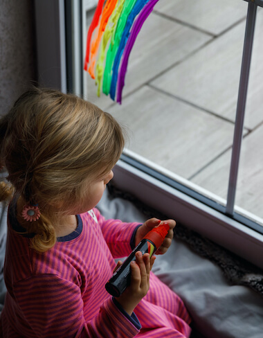 Adorable little toddler girl with rainbow